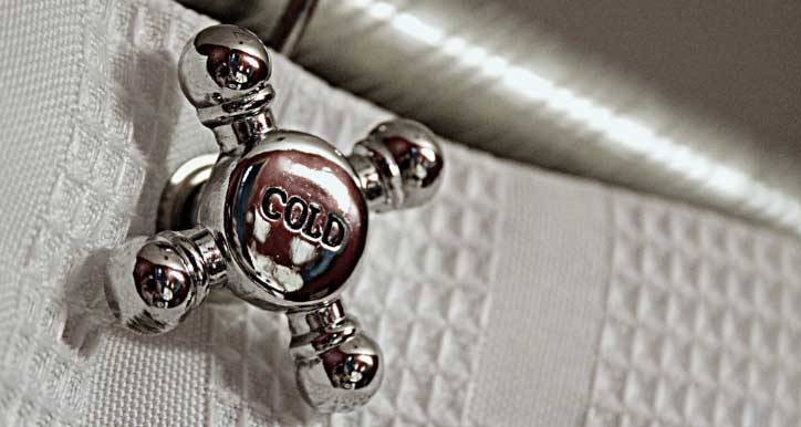 Image of a cold water faucet handle, indicating someone took a cold shower.